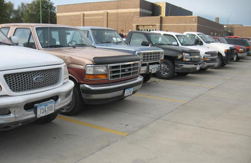 The+original+group+of+students+that+lined+up+their+trucks%2C+front+forward%2C+during+the+2011-2012+school+year