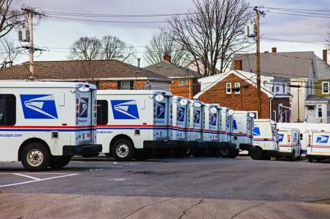 United States Postal Service Long-Life Vehicles lined up at the Waltham, Massachusetts mail handling facility this winter.