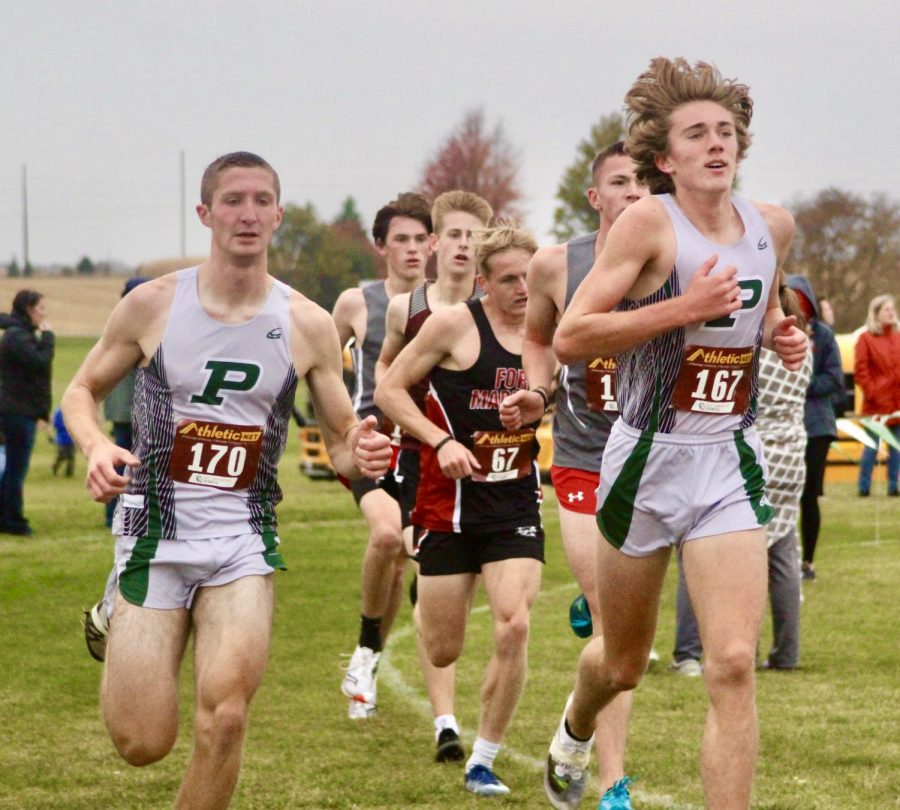 Photo of the Week: Tony Schmitz and Chas Lauman run at the State Qualifying meet hosted by PHS. Schmitz placed 1st overall and the boys team won 1st place.