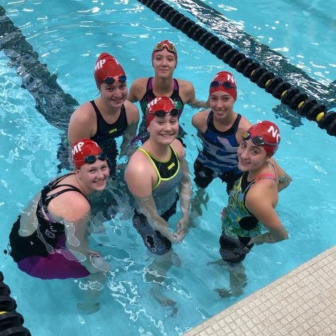 Swim team competes at districts