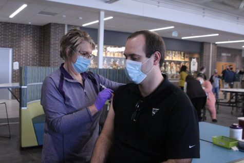 Jacob Bowers receives his vaccine.
