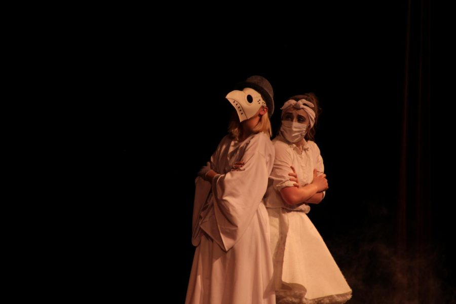 Sophomore Josephine McDonald and sophomore Aleigha Ausman)  play Addams Family ancestors.