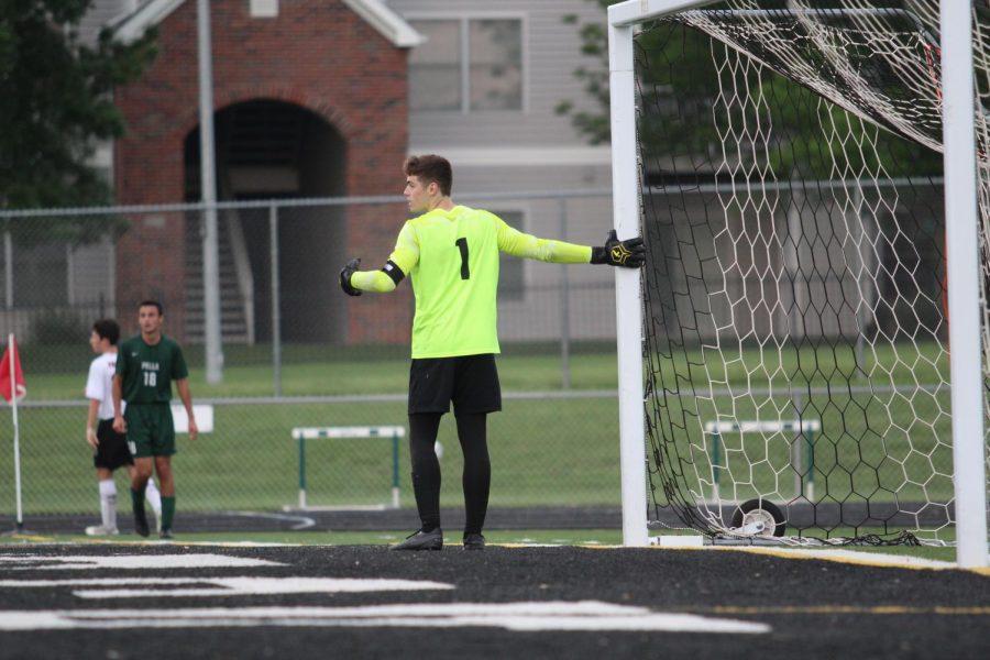 Senior Mason Holland defends the goal