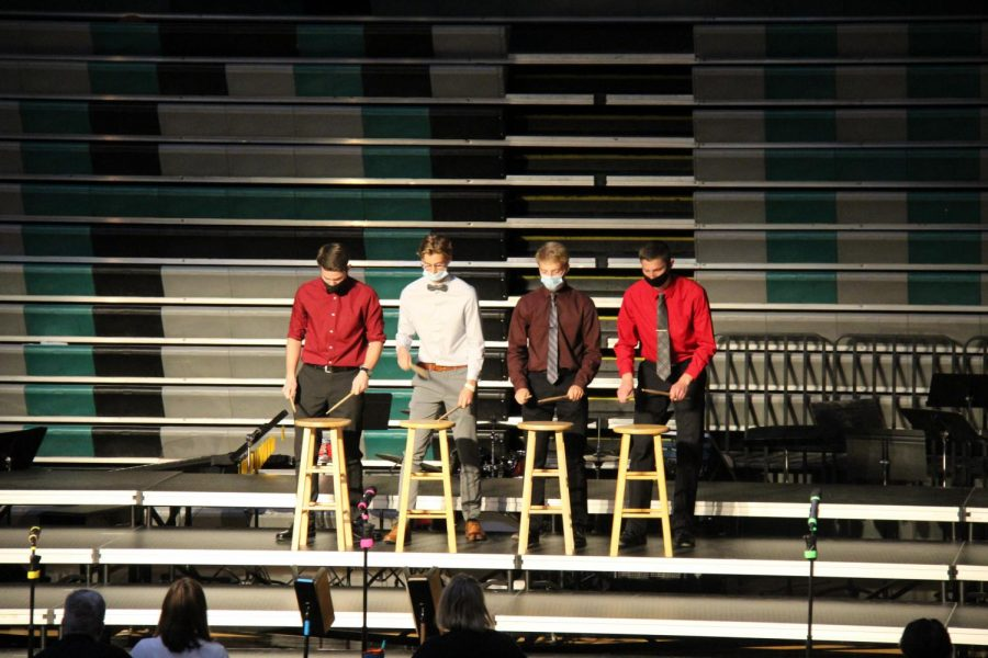 Percussionists Isaac Piersma, Brandon Winegardner, Vaughn Thompson, and Tony Schmitz perform in their quartet.
