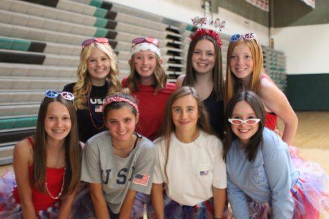 Sophomores Alexa Klein, Mallory Westerkamp, Tess Hopkins, Halle Robilliard, Stella Stelpflug, Emily Blom, Kellyn Born, and Olivia Hood show their patriotic pride on Merica Monday